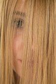 picture of peek  - a woman is peeking through her hair close up - JPG