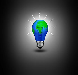 stock photo of save earth  - Earth in light bulb isolated on a black background - JPG