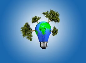 foto of save earth  - Earth in light bulb isolated on a blue background - JPG