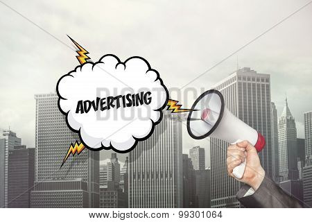 Advertising text on speech bubble and businessman hand holding megaphone