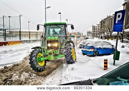 Metkovic, Croatia - February 12: Tractor Cleans The Streets Of Large Amounts Of Snow In Metkovic, Cr