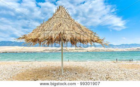 Beach Umbrella On A Windy Day