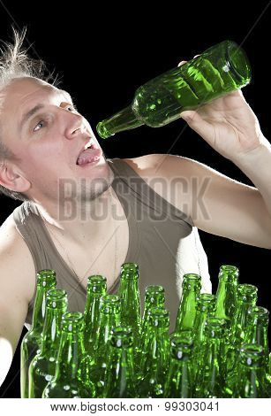 The tipsy man wants to drink the last drink of beer from an empty bottle