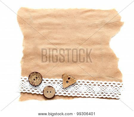 ragged piece of old paper with lace and button