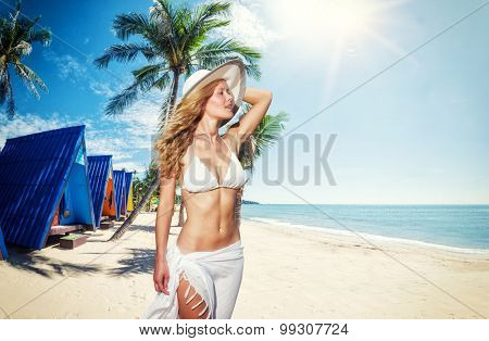 Blonde woman at the tropical beach of  Koh Samui, Thailand