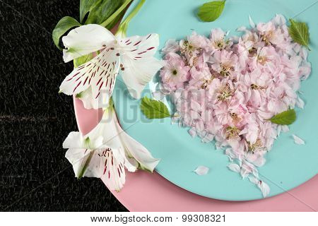 Tableware with flowers on table close up