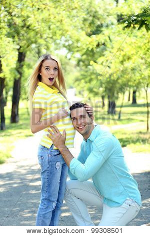 Young pregnant woman with husband in park