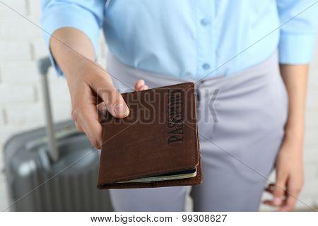 Female hand holding passport, closeup