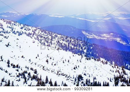Snowy mountains in wintertime with sunlight