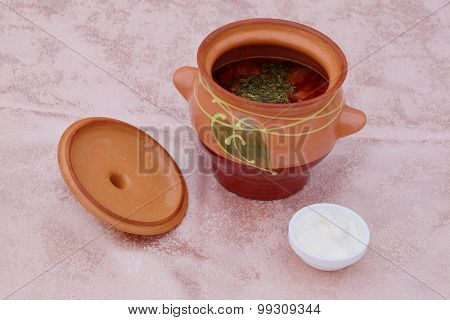 The image of soup in a pot
