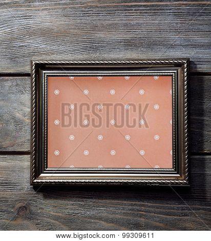 Old frame on wooden background