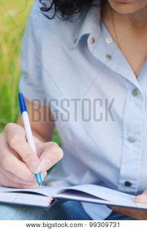 Close-up image of a girl with a note-book