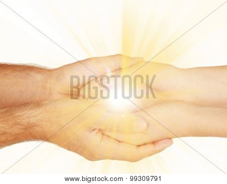 The light in young woman and man hands