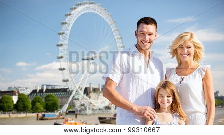 summer holidays, travel, tourism and people concept - happy family over london ferry wheel background