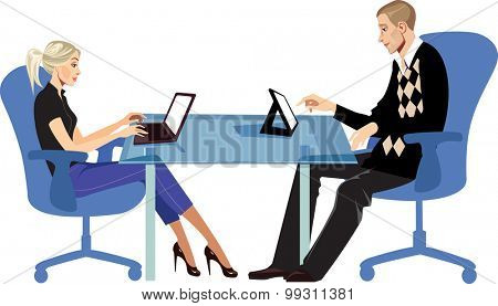 men and woman sitting at a table with a laptop and a tablet