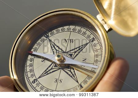 Man holding compass for direction