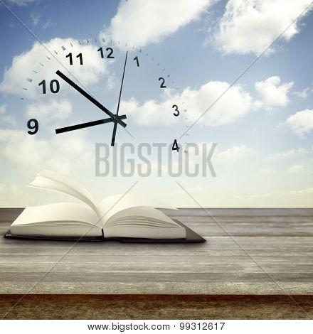 Open book in front of clock in sky