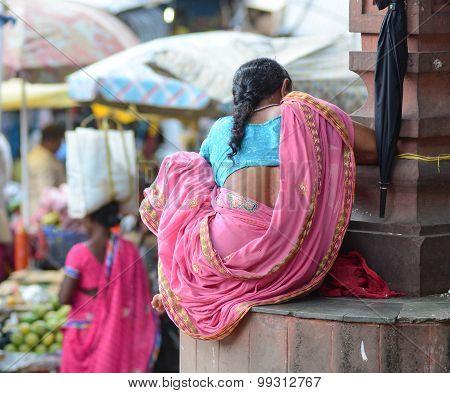 Indian Women Sitting On The Street