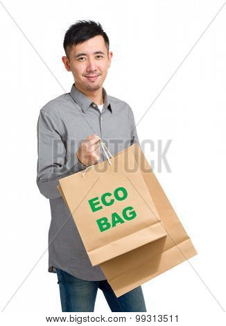 Asian man hold with shopping bag and showing eco bag
