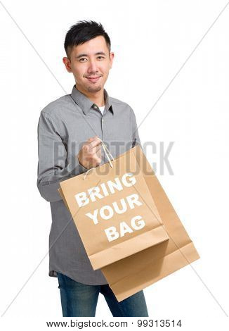 Asian man hold with shopping bag and showing bring your bag