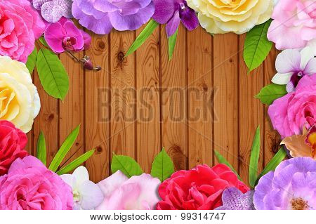 Beautiful flower blossom and leaf frame on brown wood background