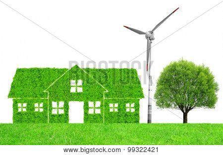 Green house symbol with wind turbine and tree on meadow