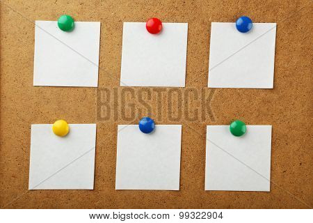 Colorful stickers on brown background