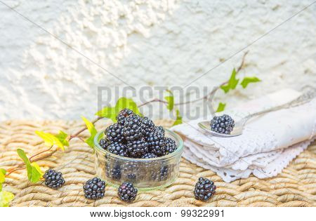 Blackberry and green leaves with natural background.