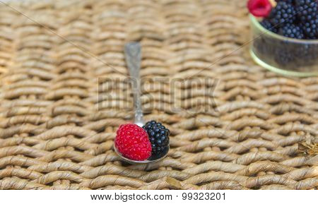 Vintage spoon and blackberries background.