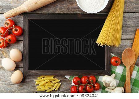Black Chalkboard For Menu On Grey Wooden Background