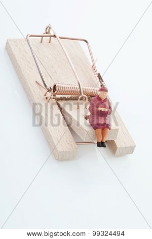 Figurine Of Woman Pensioner On Mouse Trap