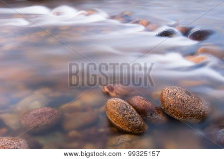 Pebbles in flowing shallow stream