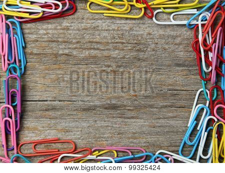 Paper Clip On Grey Wooden Background