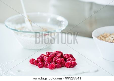 Red Raspberries, Muesli Bowl In The Background
