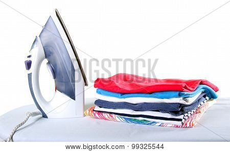 Colorful Clothes And Electric Iron