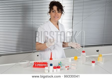 Caucasian Female Scientist Pipetting Infected Cells