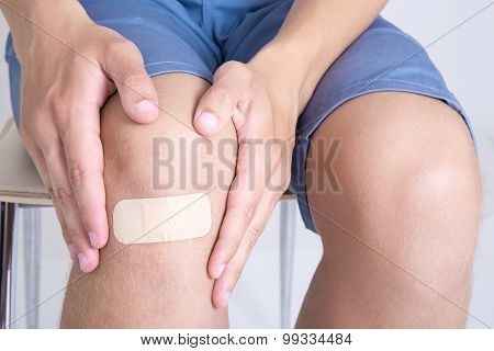 Young Man With Adhesive Bandage On Knee
