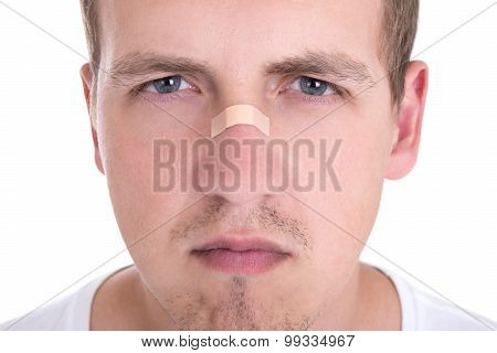 Young Man With Adhesive Tape Over His Nose