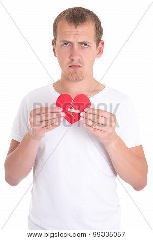 Divorce Concept - Sad Man Holding Broken Heart With Plaster