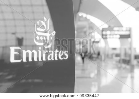 DUBAI, UAE - MARCH 31: Emirates logo on red background. Dubai International Airport is an international airport serving Dubai. It is a major airline hub in the Middle East