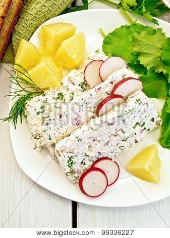 Terrine of curd with potatoes on board