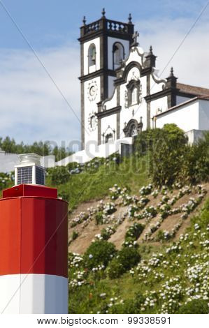 Lighthouse And Traditional Azores Church In Porto Formoso. Sao Miguel