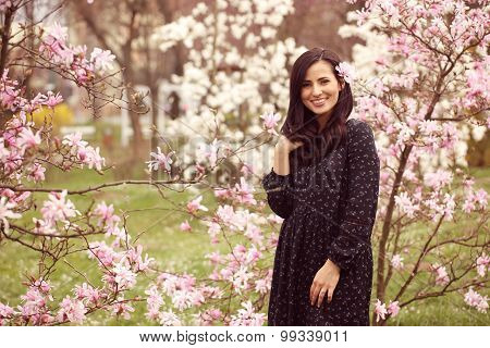 Beautiful Woman Surrounded By Flowers