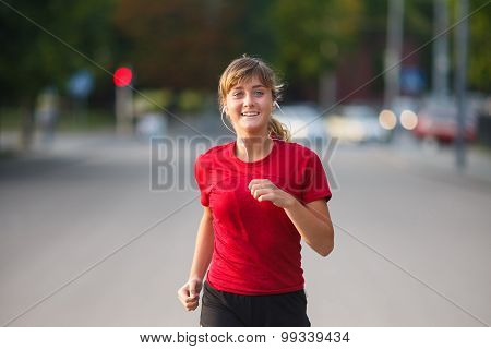 Girl Running In A City