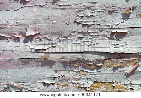 Cracked Paint On A Wooden Wall From Planks. Grunge Background