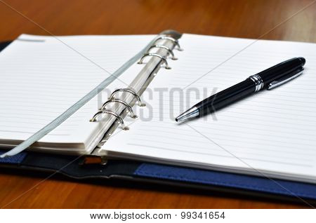 A pen lying down on white paper