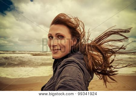 in windy weather walking female