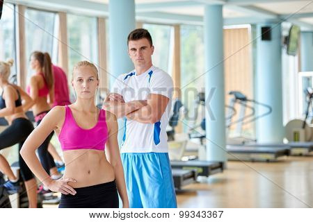 group portrait of healthy and fit young people in fitness gym