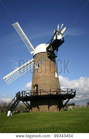 Windmill with blue sky as background