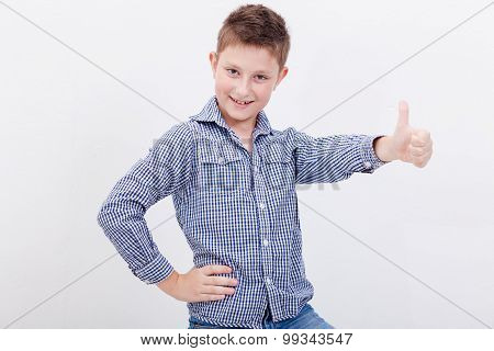 Portrait of happy boy showing thumb up gesture